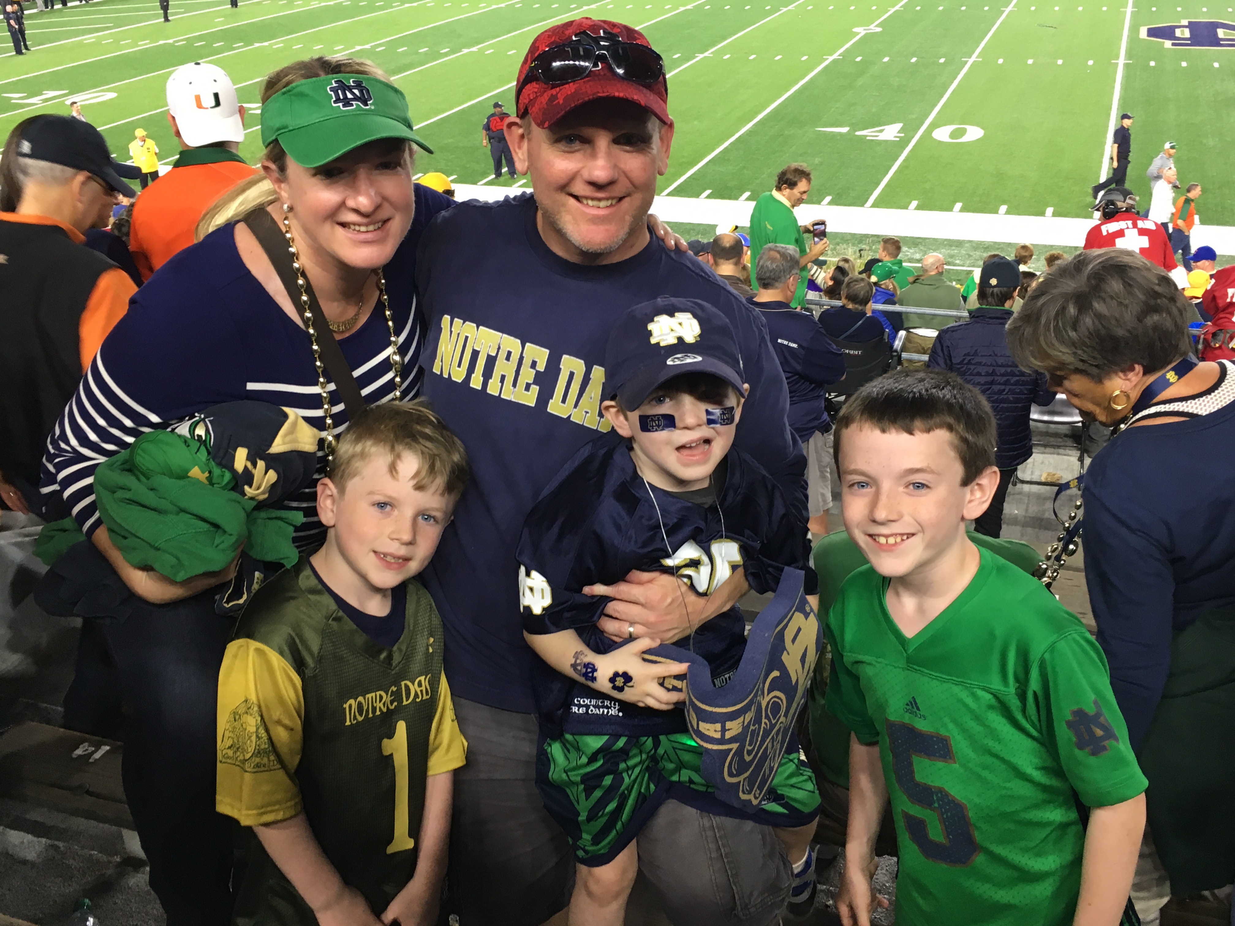 1. Notre Dame - Young family on field